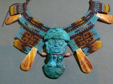Traditional Incan necklace made with jade, shells and knotwork