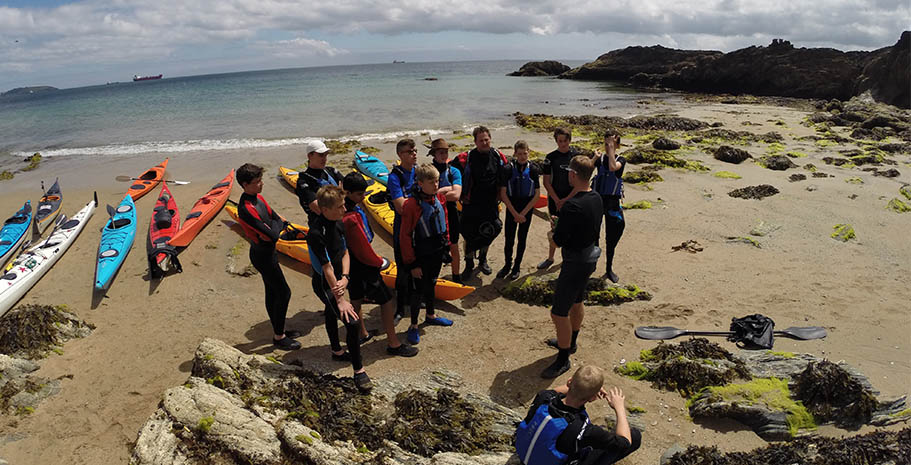 Reading the surf and managing expectations for the paddle of the day in Cornwall. A team briefing on the sand.