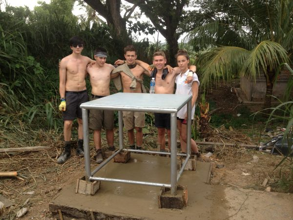 Base for the water tower - a metal table on a concrete pad. The team are proud of their work.