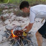 Cooking a dinner on an open fire on the beach in Borneo
