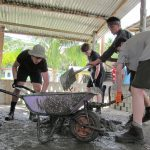 students young people mixing cement on a humanitarian project in Borneo