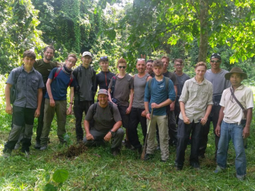 group of school student sin the jungle together group photo