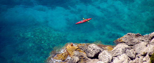 Sea Kayak expedition with blue waters and sea shore