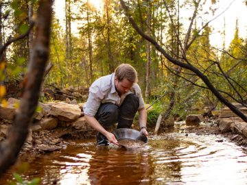 panning for gold in the wild