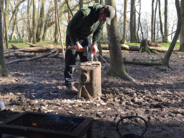 carving a spoon using an axe