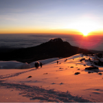 Tanzania Kilimanjaro expedition with sunset or sunrise over the snow capped peak