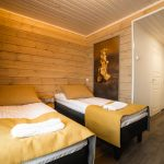 accomodation arctic gold log cabin tiny house hotel room bedroom beds